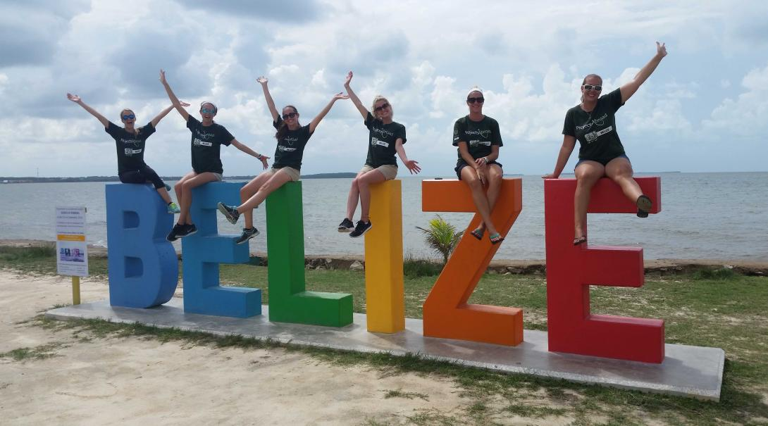 Projects Abroad volunteers posing in a Belize sign after finishing their projects.